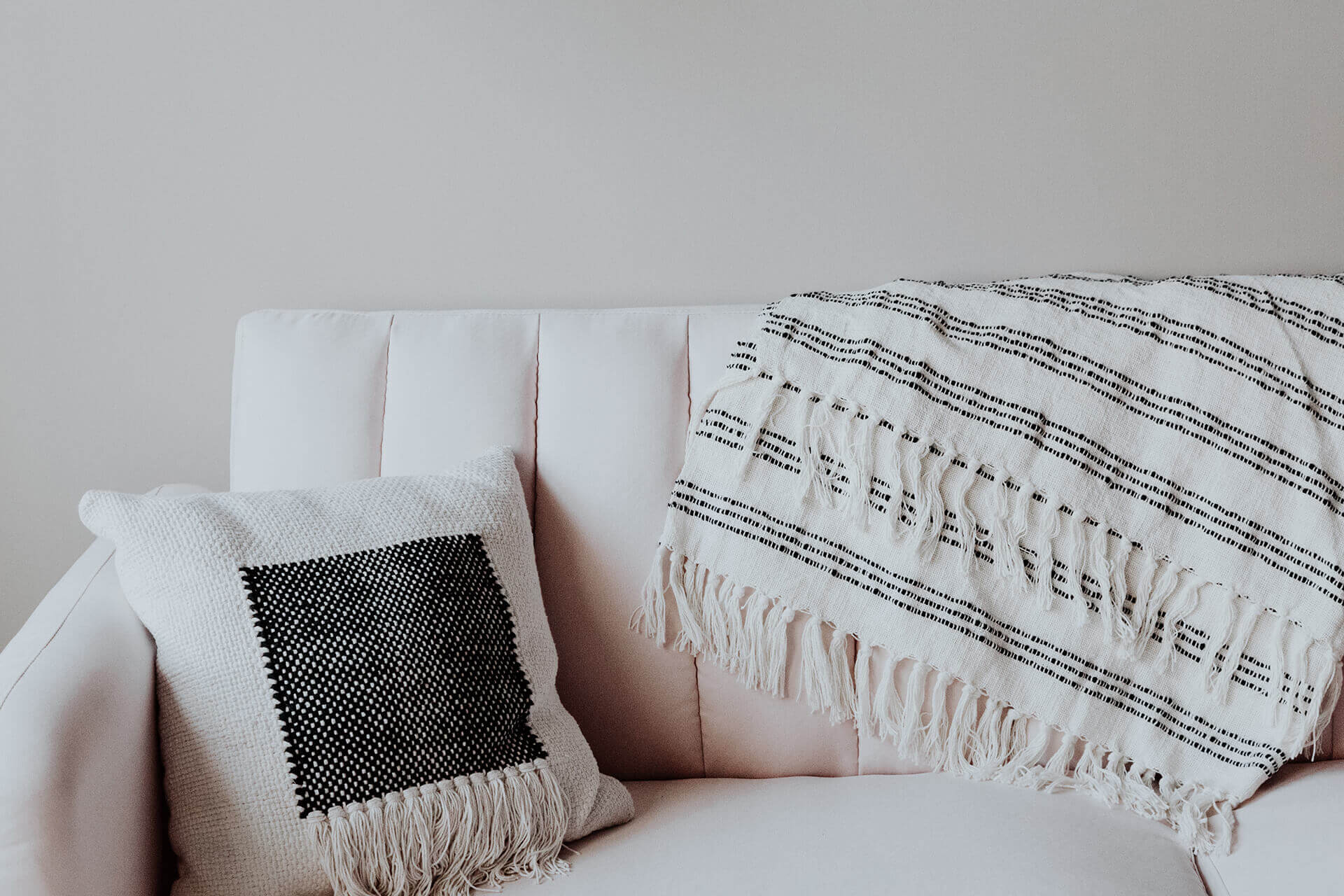 Comfortable couch, pillow and blanket welcome individual therapy clients that seek treatment with different therapeutic approaches.